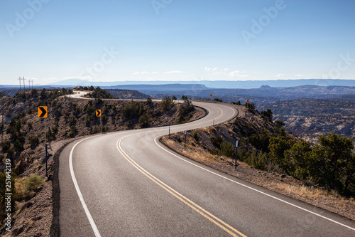 Scenic road in the desert during a vibrant sunny day Canvas Print