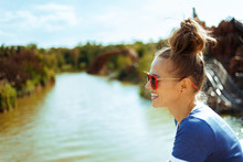 Solo Traveller Woman Exploring Countryside While Having River Cr