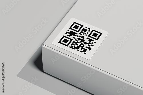 Valokuva  QR code on white box isolated on light background. 3d rendering.