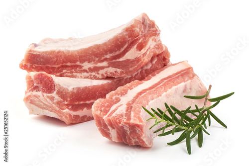 Carta da parati Raw meat ribs with rosemary, close-up, isolated on white background