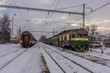 Lipany station in winter snow morning with trains and platforms