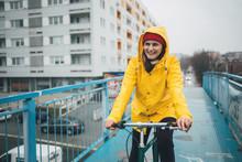 Rainy Day Cycling And Wearing Raincoat