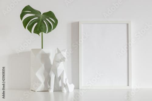 White frame mock up, origami vase decoration and monstera. Fototapete