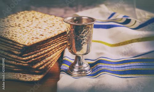 Fototapeta Passover wine and matzoh jewish holiday bread wooden board. obraz