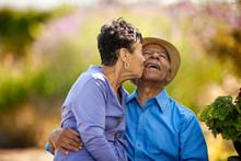 Senior Woman Kissing Her Happy...