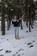 Young teenage happy girl playing with snow at Troodos mountains in Cyprus