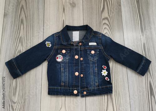 Denim jacket with stickers.