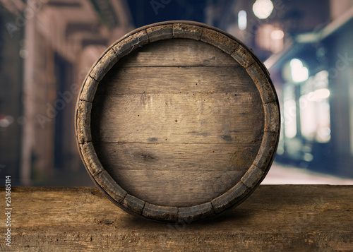 Fotografiet Background of Barrel and Worn Old Table of Wood