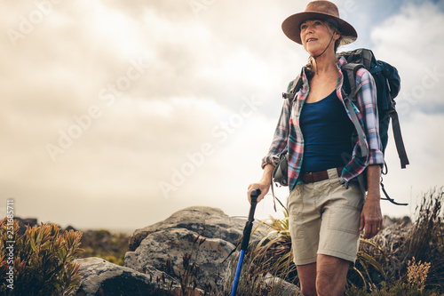 Fotografia, Obraz Portrait of a woman on a trekking expedition