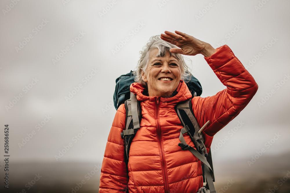 Fototapety, obrazy: Woman trekker enjoying the beauty of nature