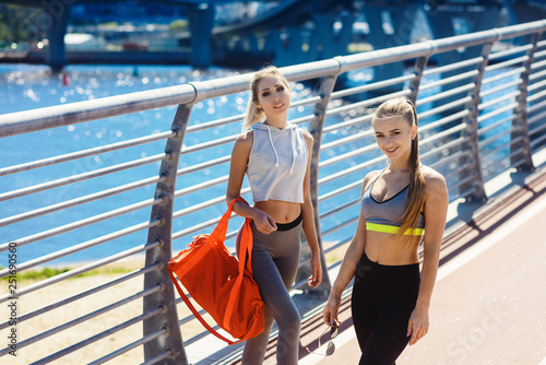 Two young beautiful women in sportswear Canvas Print