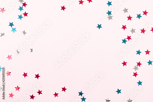 Canvas Prints Countryside Festive pink background. Shining stars on light pink pastel background. Christmas. Wedding. Birthday. Flat lay, top view, copy space
