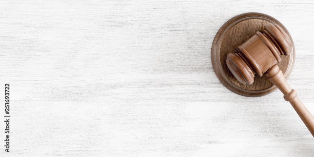 Fototapeta Judge's gavel on light background, Law and Justice concept. Flat lay, top view, copy space
