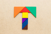 Tangram Puzzle In Alphabet Letter T Shape On Wood Background