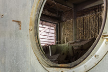 Looking Through Circular Opening Into Abandoned Factory