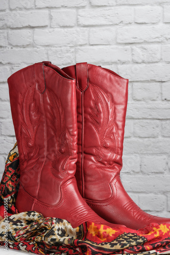Fotografia, Obraz  red coyboy style cowgirl boots  with decorative stitching and a southwest patter
