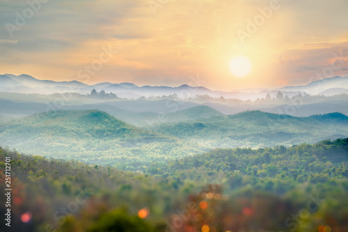 Beautiful foggy winter sunrise in mountains of northern Thailand.