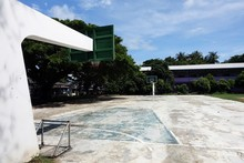 Outdoor Cement Basketball Court With Pale Color And Peel Off Surface. There's Nobody Caused By Off Days, Abandoned, Deserted. Or Pandemic Lockdown.