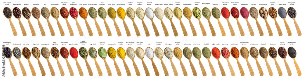 Fototapety, obrazy: Spices and herbs for cooking delicious food. Collection seasoning is poured into wooden spoon. Flavoring isolated on white background.