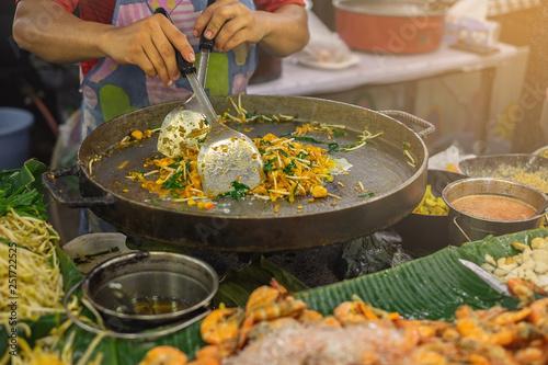 Photo  Local street food stalls making Pad Thai in Bangkok Thailand.