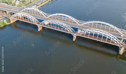 Photo  Aerial top view of automobile and railroad Darnitsky bridge across Dnieper river