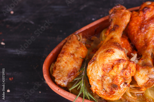 Foto op Aluminium Kip Chicken in paprika sauce baked in the oven in pottery. Chicken legs and wings