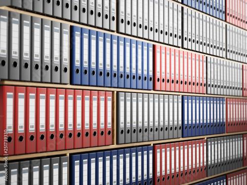 Fotografie, Obraz  Multi colored folders arranged inside wooden shelves