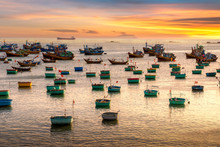 Traditional Vietnamese Boat In The Basket Shaped On Fishing Port At Fishing Village In Sunset Sky , Binh Thuan, Vietnam. Landscape. Popular Landmark, Famous Destination Of Vietnam.
