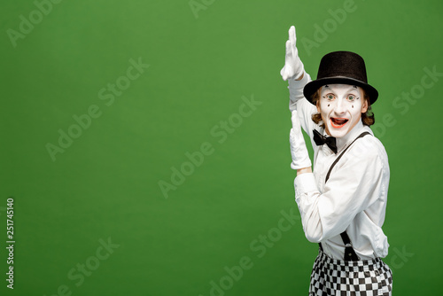 Portrait of an actor as a pantomime with white facial makeup posing with express Canvas Print