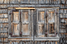 Weathered WIndow Shutters Of An Old Abandoned Farmhouse