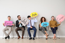 Young People Holding Speech Bubbles With Words JOB And CAREER Indoors