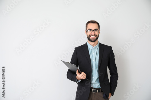 Portrait of young businessman on light background
