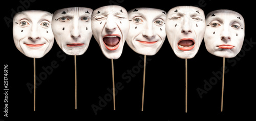 Masks with different emotions of pantomime on the black background Fototapeta