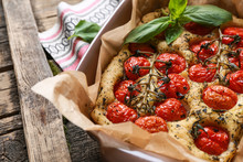 Baking Dish With Tasty Italian Focaccia On Wooden Table