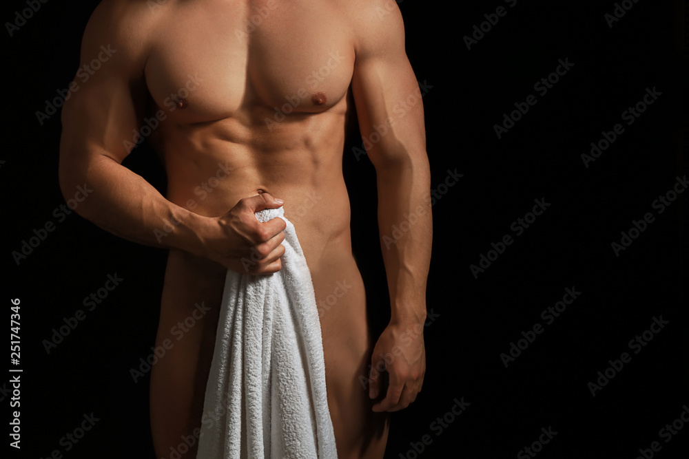 Fototapety, obrazy: Muscular sexy bodybuilder with towel on dark background