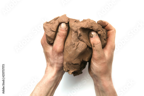Obraz na plátně Natural clay piece in hands  isolated on white background