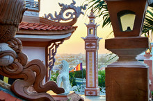 View Of The City Of Phan Thiet Through The Sculptural Compositions Of Buddhist Temple Buu Son. Binh Thuan, Vietnam.