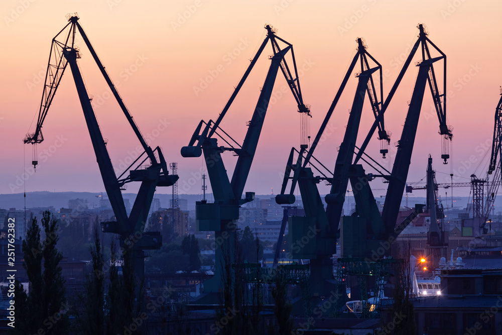 Fototapety, obrazy: Gdansk, Poland. Silhouettes of port cranes at sunset