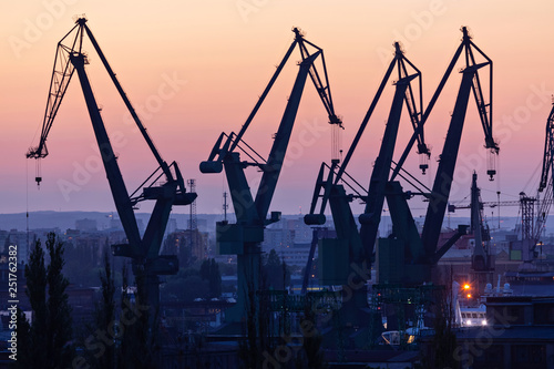 Gdansk, Poland. Silhouettes of port cranes at sunset