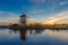 The Sunset View Of Traditional Dutch Windmill In Kinderdijk, Netherlands