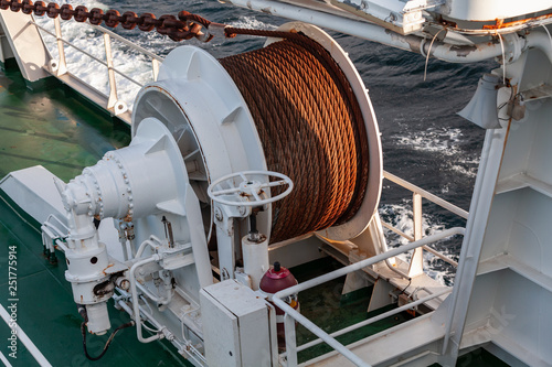 Bow anchor winch on ship deck Fotobehang