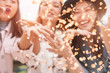 canvas print picture - Blurred asian friends having fun throwing confetti at party outdoor - Young trendy people enjoying fest event - Hangout, friendship, trends and youth concept - Defocused photo
