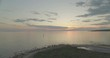 Aerial landscape 4k shot with drone above sea at sunset