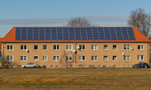 Generic Building With Large Solar Panels, A Building In East Germany With Large Solar Panels On The Roof