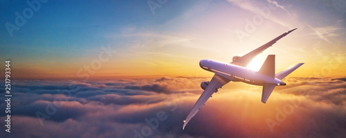 Passengers commercial airplane flying above clouds