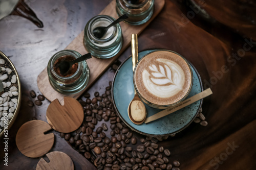 Wall Murals Cafe Hot Coffee Latte or Cappuccino cup with Coffee beans on the wooden table