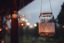 Mason Jar Candle Hanging On Tree For Wedding Decor. Evening Light. On The Window