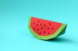 Leinwandbild Motiv Paper watermelon slice on blue pastel background. Creative idea. Art food concept.