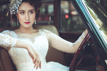 Portrait Of Young Asian Woman Wearing A White Dress With Classic Car. Concept Beauty And Fashion Retro Style