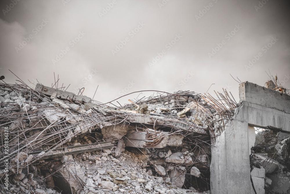 Fototapeta Ruin in a war zone with a damaged concrete building